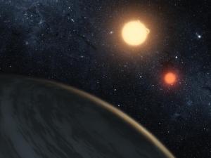 Recreación artística de Kepler-16b y sus dos soles